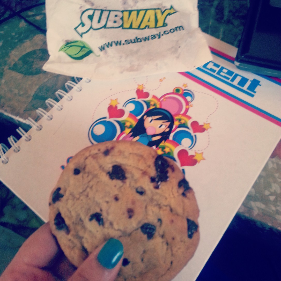 Random picture of my colored thumb nail on a Subway Chocolate Chip Cookie!! xD